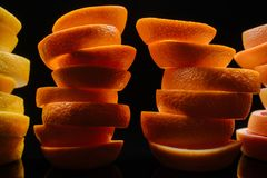 close-up shot of stacked slices of various ripe citrus fruits slices stock photo