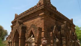 Statues built around a temple. A close up shot of statues of elephants and other animals surrounding an ancient building stock video footage