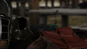 Close up shot of steel plate helmet and leather equipment of medieval warrior. Stock footage stock footage