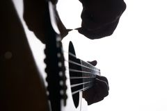Close up shot of strings and guitarist hands playing acoustic guitar Royalty Free Stock Photos