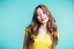 Close up shot of stylish young woman smiling against blue background. Beautiful female model with copy space. Emotions, joy, happiness concept Stock Photo