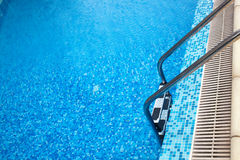 Close-up shot of swimming pool with ladder Stock Photo