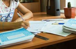 Close up shot of teacher desk. Academic teacher holding pen and stock photo