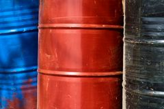 Three old and rusty barrels. Close-up shot of three old, scratched and rusty colorful barrels royalty free stock photography