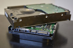 Close up shot to a hard disk drive on a wooden background Royalty Free Stock Photography
