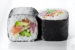 Close up shot of traditional fresh japanese sushi  rolls  on a white background Stock Photography