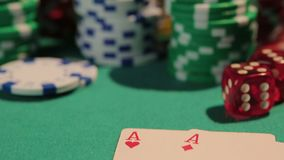 Close-up shot of two aces on poker table, defocused chips on background, casino. Stock footage stock video footage