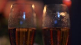 Close up shot of two glasses of champagne. Valentines day. making a marriage proposal. stock video footage