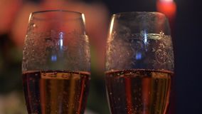 Close up shot of two glasses of champagne. Valentines day. making a marriage proposal. Two beautyfull glasses and candle light stock video