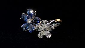 Flower Shaped Ring. Close-up shot of two sparkling,shining white and blue flower shaped ring with diamonds and saphire jewelery stock video footage