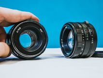 Close up shot of two vintage camera lenses  Stock Photography