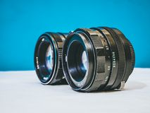 Close up shot of two vintage camera lenses  Stock Image