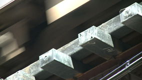 Close-up shot under Chicago's L train. Chicago's elevated train system.  Similar to other cities subway system stock video footage
