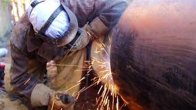 Close up shot welder until welding, sparks flying around. stock video