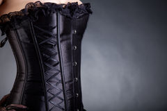 Close-up shot of a woman in black corset Stock Photo