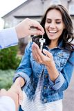 Close-up shot of woman buying new house and shaking hands. With realtor Stock Photo