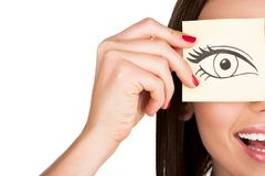 Woman covering eye with sticker Stock Photography