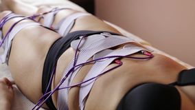 Close up shot of woman at electro stimulation therapy. Electro bio stimulation of thighs and buttocks. Rejuvenate