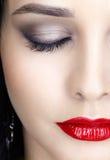 Close-up shot of woman face. Close-up shot of young brunette woman face with evening makeup Stock Photos
