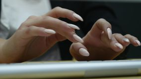 Close up shot of woman hand typing on the computer keyboard in the modern office at the table.  stock video