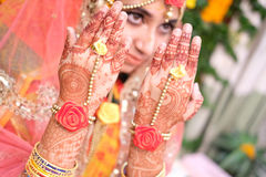 Close up shot of Woman Hands with black mehndi tattoo. Hands of Indian bride girl with black henna tattoos. Stock Photography