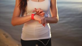 Close up shot of woman hands touching screen on smart watches outdoor. Close up shot of woman hands touching screen on smart watches outdoor near the sea during stock video