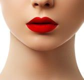 Close-up shot of woman lips with  red lipstick. Beautiful perfec Stock Photo