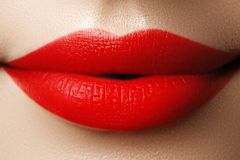Close-up shot of woman lips with red lipstick. Beautiful perfect. Lips. Sexy mouth close up. Beautiful wide smile of young fresh woman with full lips Royalty Free Stock Photos