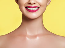 Close-up shot of woman lips with red lipstick. Beautiful perfect lips. Woman teeth after whitening. Happy smiling woman. Dental health concept. Close-up shot of stock images