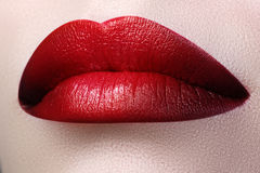 Close-up shot of woman lips with red lipstick Royalty Free Stock Photo