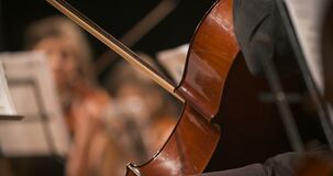 Woman playing cello on concert stock footage