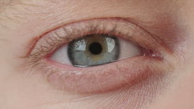 Close up shot of a woman's eye stock footage