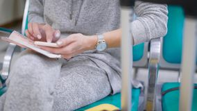Close up shot of a woman`s hands, who undergoes online registration using her passport information. Close up shot of a woman`s hands who holds a smartphone and a stock footage