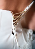 Close-up shot of woman in white corset rear view. Close-up shot of woman in white corset, rear view stock image