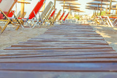 Close up shot of a wooden beach path texture with some sand Royalty Free Stock Photo