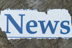 A close up shot of the word News cut out in a newspaper Royalty Free Stock Photography