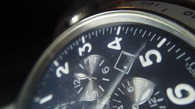 Close up shot of a wrist watch with white clock hands moving. stock video footage