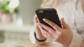 Close up shot of a young girl hands, who holding a smartphone. stock video footage