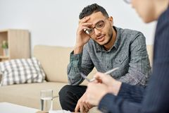 Psychologist Consulting Depressed Patient royalty free stock photo