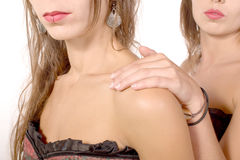 Close up on the shoulder of a young woman. Close up on the shoulder of a young women with hand Stock Images