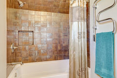 Close up of shower with natural stone tile wall trim Royalty Free Stock Photo