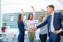 The business group makes one-on-one hands while working in the office. A close-up shows how a business group makes one-on-one hands while working in the office Royalty Free Stock Photo