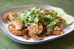 Close up shrimp with garlic. Close up shrimp with pepper and garlic in Thai style dish Stock Photography