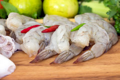 Close up of shrimp, squid, and fresh vegetables Royalty Free Stock Photo