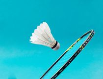 Close up shuttlecock and badminton racket. Stock Image