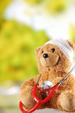 Close up Sick Teddy Bear Toy with Stethoscope Royalty Free Stock Image