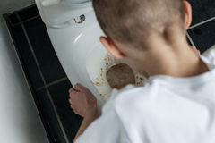 Close up Sick Young Boy Vomiting in Toilet at Home Stock Images