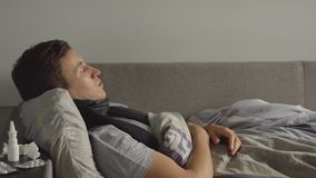 Close up of sick young caucasian man is sleep in bed Royalty Free Stock Photos