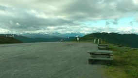 Close up side of car parking on the mountain road. Road in the mountains. Norway stock footage