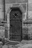 Close up of a side entrance to the Gothic Vysehrad cathedral in Prague. Close up of the entrance to the Gothic Vysehrad cathedral in Prague. Door and portal Stock Image